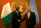 Cote d'Ivoire's President Alassane Ouattara (L) is greeted by United Nations Secretary General Antonio Guterres at the U.N. Headquarters in New York City, U.S., September 17, 2017. REUTERS/Joe Penney - RC15F4B1A6F0