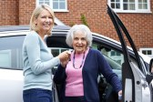 Female Neighbor Giving Senior Woman A Lift In Car. iStock/Highwaystarz-Photography