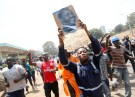 A supporter of Kenyan opposition National Super Alliance (NASA) coalition, carries a banner depicting Kenyan opposition leader Raila Odinga during a protest along a street in Nairobi, Kenya, October 11, 2017. REUTERS/Baz Ratner - RC18EBAB39B0