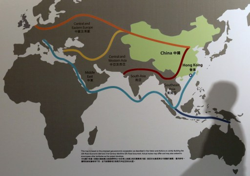"""The shadow of a participant is seen on a map illustrating China's """"One Belt, One Road"""" megaproject at the Asian Financial Forum in Hong Kong, China January 18, 2016. REUTERS/Bobby Yip - GF20000098473"""