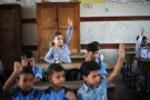 Palestinian schoolchildren attend a lesson in a classroom on the first day of a new school year, at a United Nations-run school in Khan Young in the southern Gaza Strip August 28, 2016. REUTERS/Ibraheem Abu Mustafa  - S1AETXZTQKAA