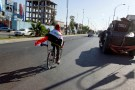 A man rides a bicycle with Iraqi flag in north of Kirkuk, Iraq October 19, 2017. Picture taken October 19, 2017. REUTERS/Ako Rasheed - RC1A98800B10
