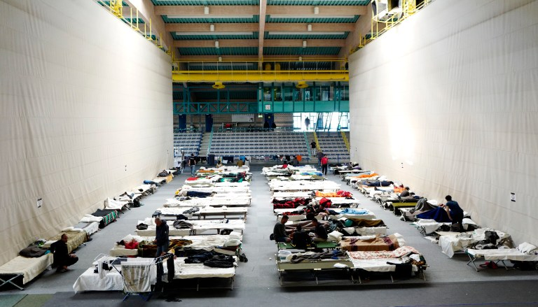 Migrants rest at an temporary shelter in a sports hall in Hanau, Germany, September 29, 2015. When the flood of Middle Eastern refugees arriving in Europe finally ebbs and asylum-seekers settle down in their new homes, Germany could unexpectedly find itself housing the continent's largest Muslim minority. REUTERS/Kai Pfaffenbach TPX IMAGES OF THE DAY - LR1EB9T14TXW2
