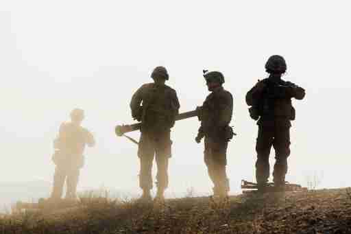 U.S. soldiers from D Troop of the 3rd Cavalry Regiment walk on hill after finishing with a training exercise near forward operating base Gamberi in the Laghman province of Afghanistan