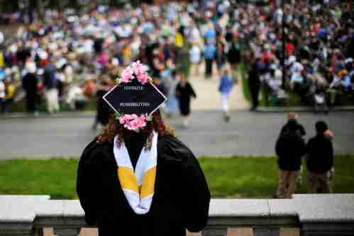 "A senior with ""Infinite Possibilities"" written on her cap waits to graduate during Commencement at Smith College in Northampton, Massachusetts, U.S., May 21, 2017."