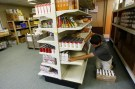 Photo: Young man works organizing grocery store shelves.