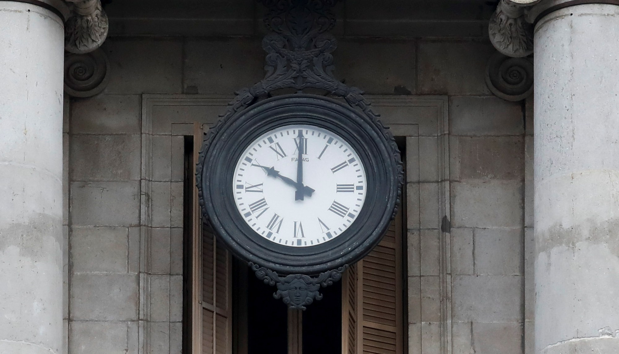 A clock in Sant Jaume square is seen at ten o'clock.