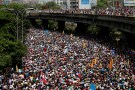 "Demonstrators march during the so-called ""mother of all marches"" against Venezuela's President Nicolas Maduro in Caracas, Venezuela, April 19, 2017. Carlos Garcia Rawlins: ""That day was one of the biggest rallies up to then. There were thousands of people trying to find their way to the office of the state ombudsman after gathering in more than two dozen points around Caracas. But as in previous rallies, they were blocked by the National Guard. Waving the country's yellow, blue and red flag and shouting 'No more dictatorship' and 'Maduro out,' demonstrators clogged a stretch of the main highway in Caracas. I remember the desperation of the people trying to escape the tear gas and not having space to run because there were so many."" REUTERS/Carlos Garcia Rawlins/File Photo SEARCH ""POY VENEZUELA"" FOR THIS STORY. SEARCH ""REUTERS POY"" FOR ALL BEST OF 2017 PACKAGES. TPX IMAGES OF THE DAY. - RC1DC4F53B10"