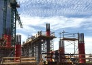 Workers are seen at a construction site .