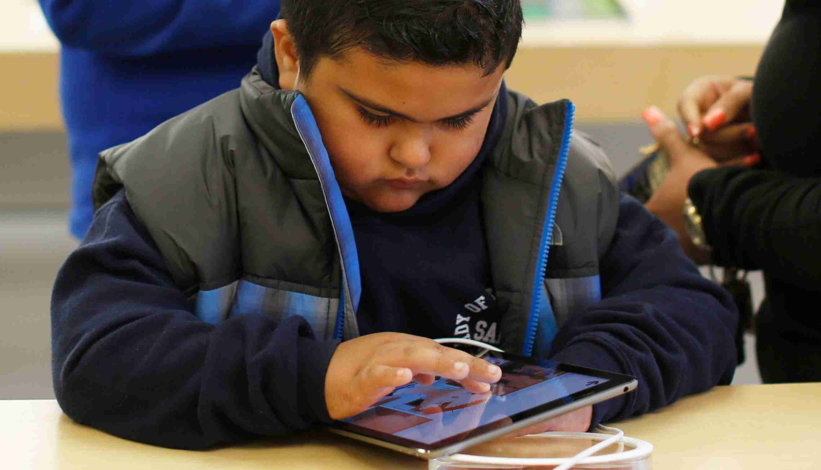 A child uses a tablet
