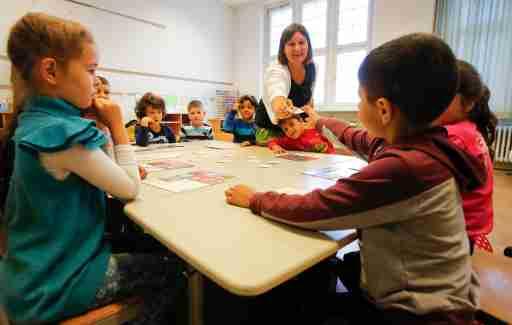 A teacher conducts a lesson in a classroom