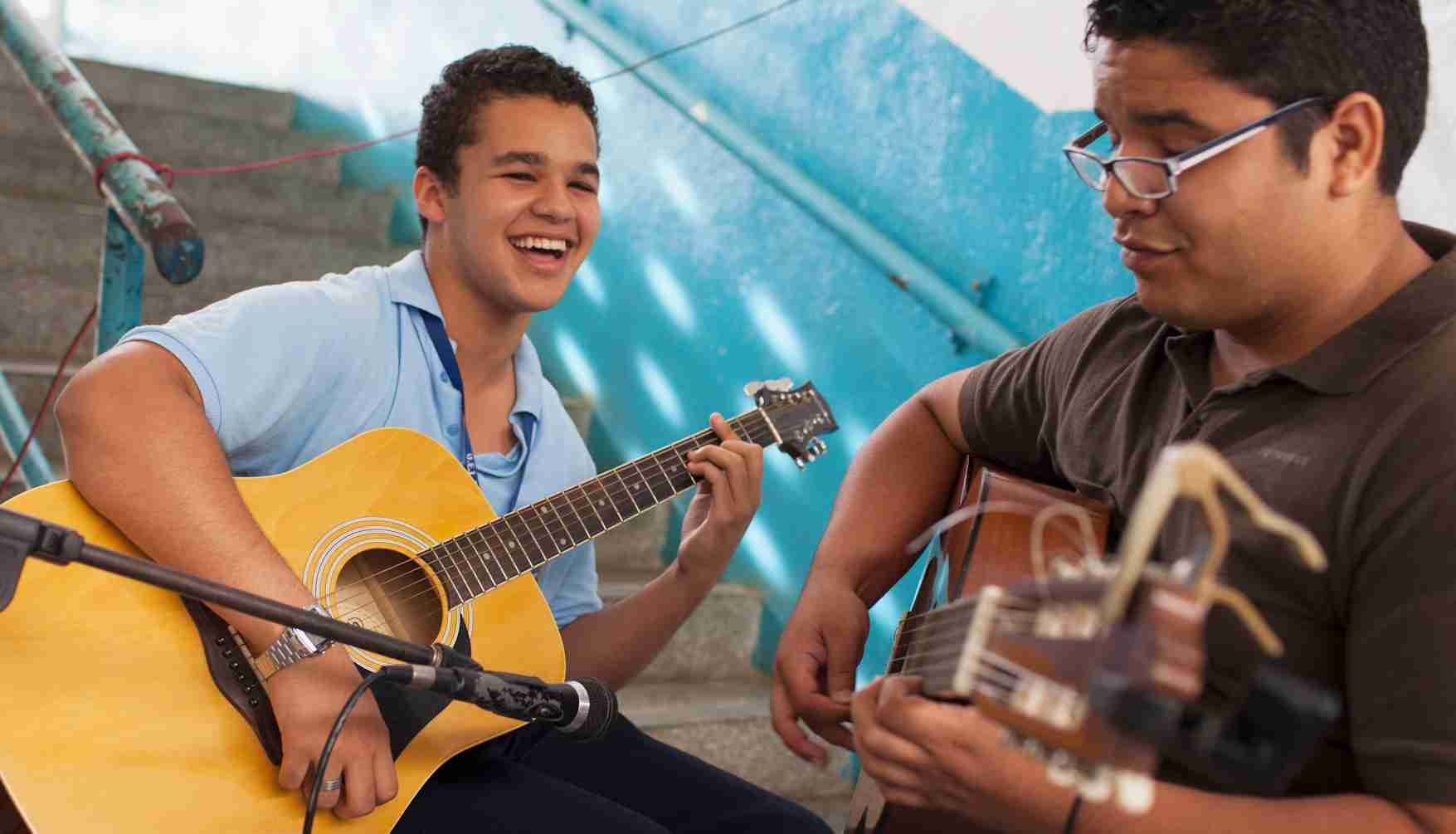 Students in Venezuela play guitars