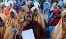 Some of the newly-released Dapchi schoolgirls wait for boarding a plane at the air force base in Maiduguri, Nigeria March 21, 2018. REUTERS/Afolabi Sotunde - RC121B5ED900
