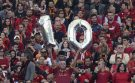 An soccer fan holds a number 10 before the Italian Cup final soccer match.