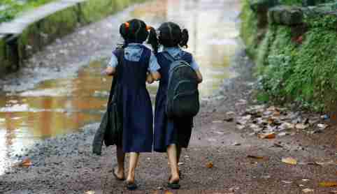 Twin girls walk to their school in Kodinji village in the southern Indian city of Kerala