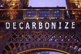 "Photo: The slogan ""Decarbonize"" is projected on the Eiffel Tower as part of the World Climate Change Conference 2015 (COP21) in Paris, France, December 11, 2015. REUTERS/Charles Platiau - LR1EBCB1BVQ2S"