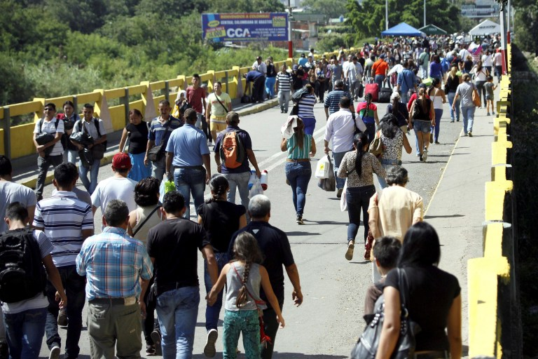 People cross the Colombian-Venezuelan border over the Simon Bolivar international bridge, in San Antonio del Tachira