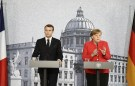 German Chancellor Angela Merkel and French President Emmanuel Macron hold a news conference at the building site of the Humboldt Forum in Berlin, Germany, April 19, 2018. Kay Nietfeld/Pool via Reuters - RC1A6FA5ADC0