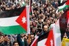 People chant slogans holding Jordanian and Palestenian flags during a protest against U.S. President Donald Trump's recognition of Jerusalem as Israel's capital, in Amman, Jordan December 29, 2017. REUTERS/Muhammad Hamed - RC1BE5E49760
