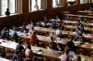 Students sit in the library of the university KU Leuven in Leuven