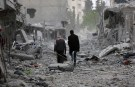 Men walk through debris in the center of Afrin, Syria March 24, 2018. REUTERS/Khalil Ashawi - RC1850B1E4F0