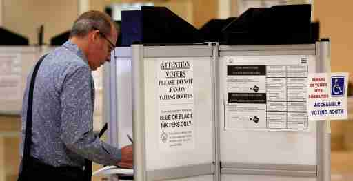 A man votes as District of Columbia voters head to the polls in the final 2016 U.S. Democratic primary in Washington, DC.