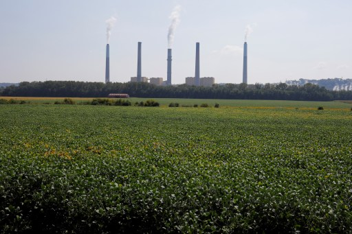 Soybeans grow in front of the Kentucky Utilities Ghent Generating Station, a coal-fired power-plant, along the Ohio River in Vevay, Indiana, U.S., September 22, 2017.  Photograph taken at N38∞45.502' W85∞02.963'.  Photograph taken September 22, 2017.   REUTERS/Brian Snyder - RC1FCCADE810