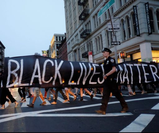 People take part in a protest against police brutality and in support of Black Lives Matter.