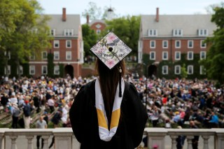 College graduate with her cap at a commencement ceremony.