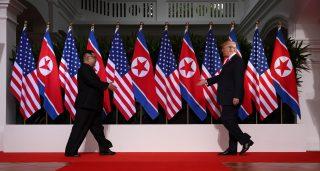 U.S. President Donald Trump and North Korean leader Kim Jong-un prepare to shake hands at the Capella Hotel in Singapore.