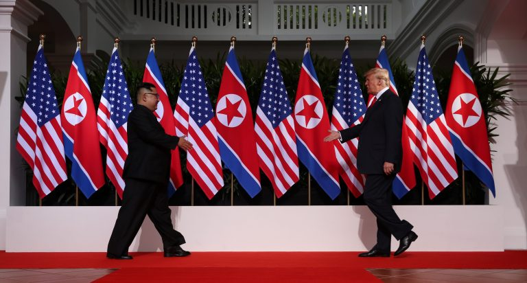 U.S. President Donald Trump and North Korean leader Kim Jong-un prepare to shake hands at the Capella Hotel in Singapore.
