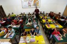 Refugee schoolchildren attend a lesson in a classroom on the first day of the new school