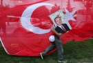 A supporters of Turkish President Tayyip Erdogan holds his picture in front of a Turkish flag, in front of Turkey's ruling AK Party (AKP) headquarters in Istanbul,Turkey, June 24, 2018. REUTERS/Goran Tomasevic      TPX IMAGES OF THE DAY - RC1D72DCC500