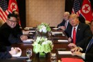 U.S. President Donald Trump is seen with North Korea's leader Kim Jong Un before their expanded bilateral meeting at the Capella Hotel on Sentosa island in Singapore June 12, 2018.