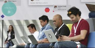 Attendees use their laptops at the Google I/O developers conference in San Francisco.