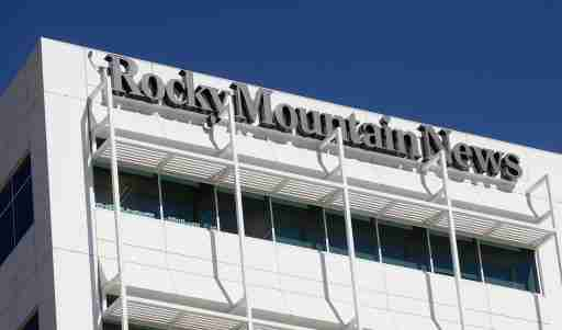 The Rocky Mountain News sign is seen on the Denver New Agency building in Denver, Colorado February 26, 2009. Media conglomerate EW Scripps Co will shutter the Pulitzer Prize-winning Rocky Mountain News after a sale process produced no qualified buyers, the company said. REUTERS/Mark Leffingwell (UNITED STATES) - GF2E52Q1P4Y01