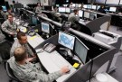 Personnel work at the Air Force Space Command Network Operations & Security Center at Peterson Air Force Base in Colorado Springs, Colorado July 20, 2010. U.S. national security planners are proposing that the 21st century's critical infrastructure -- power grids, communications, water utilities, financial networks -- be similarly shielded from cyber marauders and other foes. The ramparts would be virtual, their perimeters policed by the Pentagon and backed by digital weapons capable of circling the globe in milliseconds to knock out targets.  To match Special Report  USA-CYBERWAR/          REUTERS/Rick Wilking (UNITED STATES - Tags: MILITARY SCI TECH POLITICS) - GM1E6A51SA301
