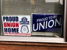 Union signs adorn the windows of a home in Dubuque, Iowa, U.S. March 29, 2018. Picture taken March 29. 2018. REUTERS/Tim Reid - RC11E756E7F0