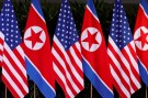 U.S. and North Korean national flags are seen during the meeting of U.S. President Donald Trump and North Korean leader Kim Jong Un at the Capella Hotel on Sentosa island in Singapore June 12, 2018. REUTERS/Jonathan Ernst - RC1C1F358640