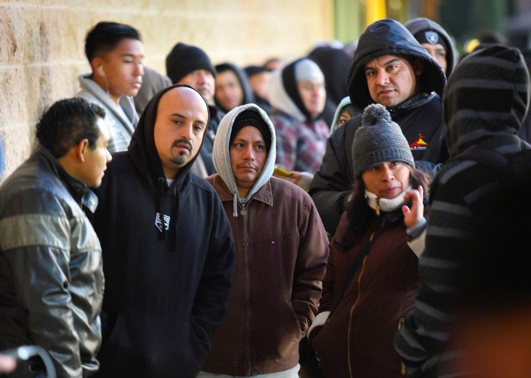 People wait in line at the California Department of Motor Vehicles in Granada Hills January 2, 2015. The California Department of Motor Vehicles on Friday begin issuing driver licenses under AB 60, the new law requiring DMV to issue a driver license to applicants regardless of immigration status in Los Angeles. REUTERS/Gus Ruelas (UNITED STATES - Tags: TRANSPORT POLITICS LAW) - GM1EB121UEN01