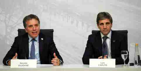 Argentina's Treasury Minister Nicolas Dujovne speaks next to Central Bank President Luis Caputo
