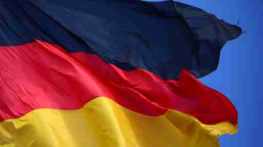 A German flag flutters in Berlin, Germany, July 2, 2018. REUTERS/Hannibal Hanschke - RC16DEB12D50