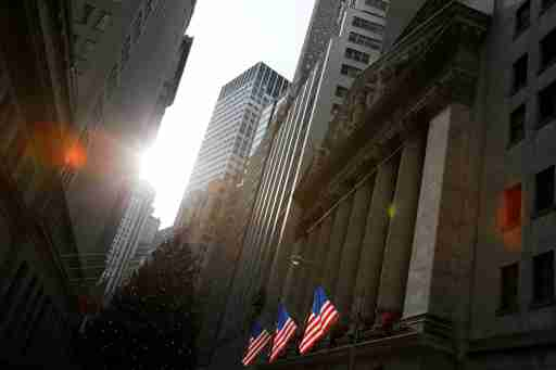 U.S. flags hang at the New York Stock Exchange in Manhattan, New York City, U.S., December 21, 2016. REUTERS/Andrew Kelly - RC166FFF9250