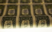 FILE PHOTO: A sheet of United States one dollar bills is seen on a light table during production at the Bureau of Engraving and Printing in Washington November 14, 2014.   REUTERS/Gary Cameron/File Photo - RC17FBCFA960