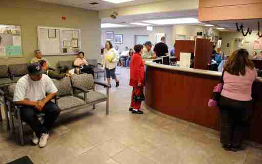 Patients check in at Clinica Sierra Vista's Lamont Community Health Center in Bakersfield, California October 20, 2009. Nowhere in the United States has more doctors at its beck and call than White Plains, one of the wealthiest cities in the nation. Nearly 3,000 miles (4,830 km) away, scaring up a doctor in Bakersfield, situated in California's economically battered Central Valley, is a lot harder. In fact, White Plains has more than twice the number of doctors per capita as Bakersfield, where needy patients until recently had to take a 2-hour bus trip to Fresno to see a diabetes treatment specialist. Picture taken October 20, 2009.  To match Special Report USA-HEALTHCARE/DOCTORS   REUTERS/Phil McCarten (UNITED STATES HEALTH IMAGES OF THE DAY)REUTERS/Phil McCarten (UNITED STATES) - GM1E5B60SNM01