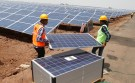 Workers carry photovoltaic solar panels for installation at the Gujarat solar park under construction in Charanka village in Patan district of the western Indian state of Gujarat April 14, 2012. According to officials, the solar park is the largest in India which will generate 210 megawatts and will be operational from April 19, 2012. REUTERS/Amit Dave (INDIA - Tags: BUSINESS ENERGY) - GM1E84E1P7C01