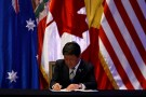 Japan's Minister of Economic Revitalization Toshimitsu Motegi signs the Trans-Pacific Partnership (TPP) trade deal, in Santiago, Chile March 8, 2018. REUTERS/Ivan Alvarado - RC17435C0BA0