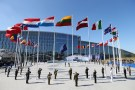 Flags of NATO member countires fly during a ceremony at the new NATO headquarters before the start of a summit in Brussels, Belgium, May 25, 2017.    REUTERS/Christian Hartmann - RC1AE63D1910