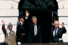 PLO Chairman Yasser Arafat (L) waves with Israeli Prime Minister Yitzhak Rabin (R) and U.S. President Bill Clinton after the signing of the Israeli-PLO peace accord, at the White House in Washington September 13, 1993. REUTERS/Gary Hershorn (UNITED STATES - Tags: POLITICS) - GM1E99E00KE01