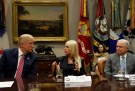 U.S. President Donald Trump listens to Attorney General Pam Bondi (R-FL), center, as Attorney General Jeff Sessions listens, during a meeting with local and state officials about improving school safety at the White House in Washington, U.S., February 22, 2018. REUTERS/Leah Millis - RC11FC38F480